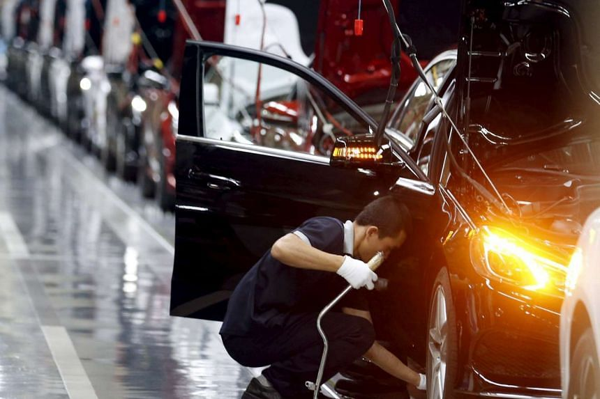 An employee works on an assembly line producing Mercedes-Benz cars at a factory of Beijing Benz Automotive Co. (BBAC) in Beijing, China on Aug 31, 2015.