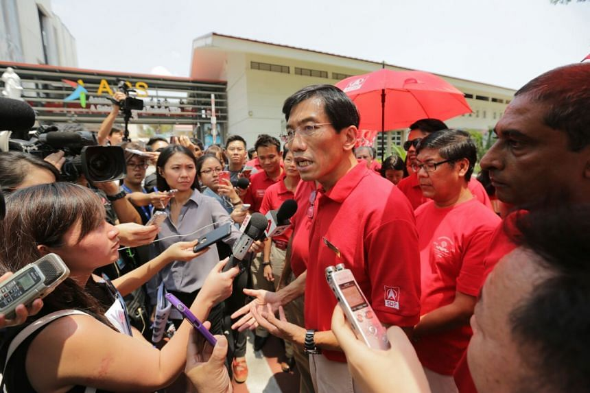Singapore Democratic Party chief Chee Soon Juan (centre) speaking to reporters.