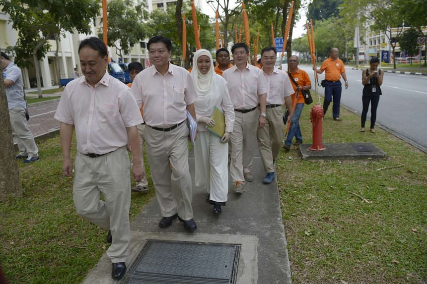 National Solidarity Party candidates for Tampines GRC (from left)  Lim Tean, Sebastian Teo, Nor Lella Mardiiiah Mohamed, Fong Chin Leong, and Choong Hon Heng walking to the nomination centre on Sept 1, 2015.