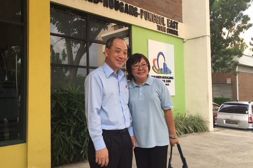 At the Aljunied-Hougang-Punggol East town council office in Hougang, Workers' Party secretary Low Thia Khiang's wife Han Mui Keow made a rare public appearance, dressed in blue.