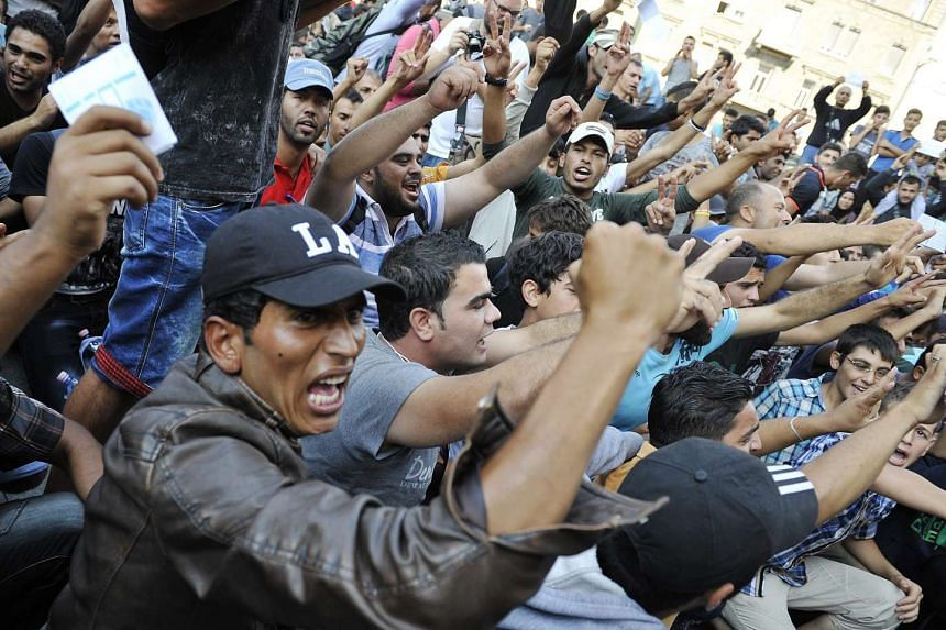 Migrants protest in front of the Keleti Railway Station in Budapest, Hungary, after police closed the station, on Sept 1, 2015.
