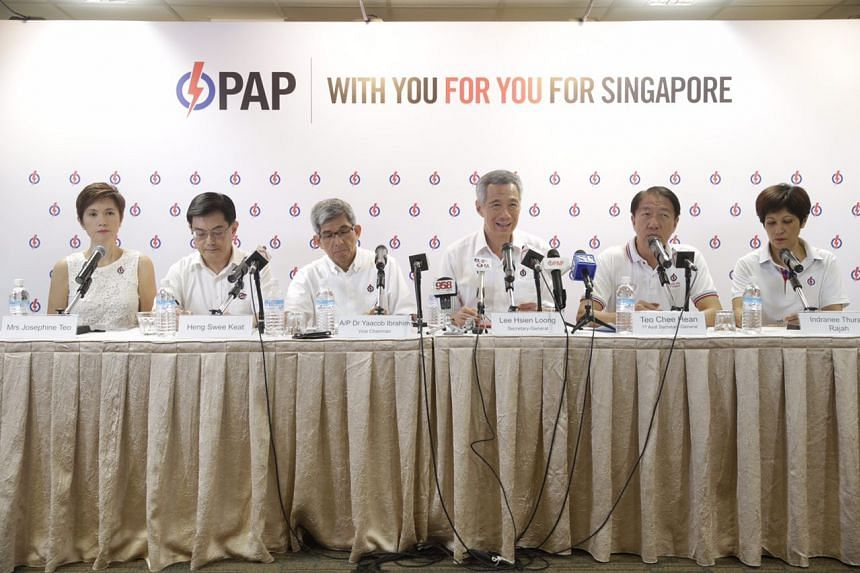 (From left) Mrs Josephine Teo, Mr Heng Swee Keat, Dr Yaacob Ibrahim, Prime Minister Lee Hsien Loong, Mr Teo Chee Hean and Ms Indranee Rajah at a press conference on Sept 1, 2015.