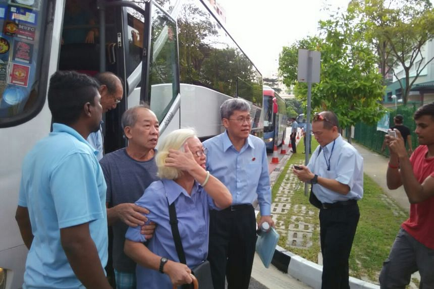 Hougang MP Png Eng Huat (in glasses) arriving at Poi Ching school - the nomination centre for the SMC.