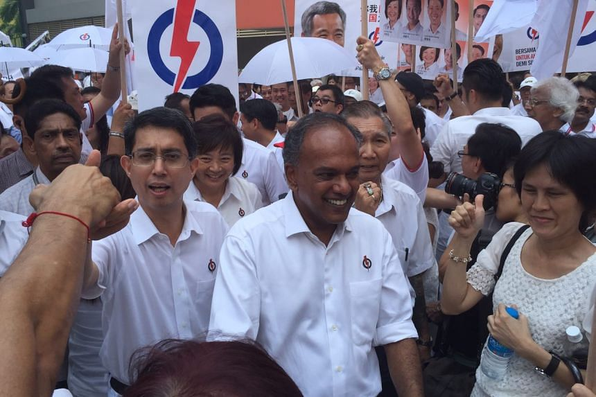 Law and Foreign Affairs Minister K Shanmugam (centre) leading his Nee Soon GRC team past supporters.