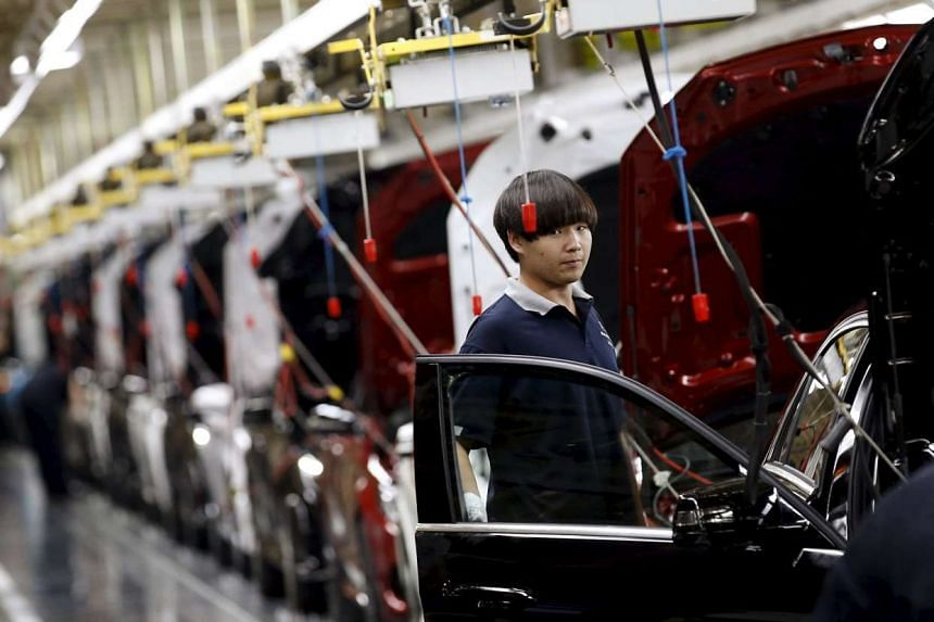An employee works on an assembly line producing Mercedes-Benz cars at a factory of Beijing Benz Automotive Co. (BBAC) in Beijing, China, August 31, 2015. Activity in China's manufacturing sector contracted at its fastest pace in three years in August