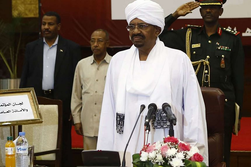 Sudanese President Omar al-Bashir (centre) chairs the general assembly for the national dialogue on Aug 20, 2015 in the capital Khartoum.