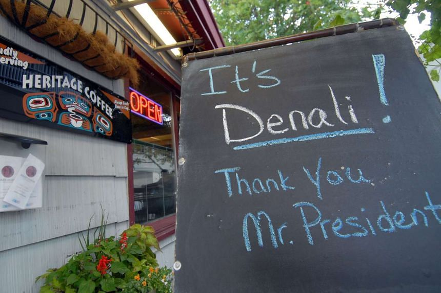A sign is seen at a coffee shop on Monday across the street from the Dena'ina Convention Center, in Anchorage, Alaska where US president Barack Obama will deliver a speech, after announcing a decision to rename Mount McKinley, the tallest mountain
