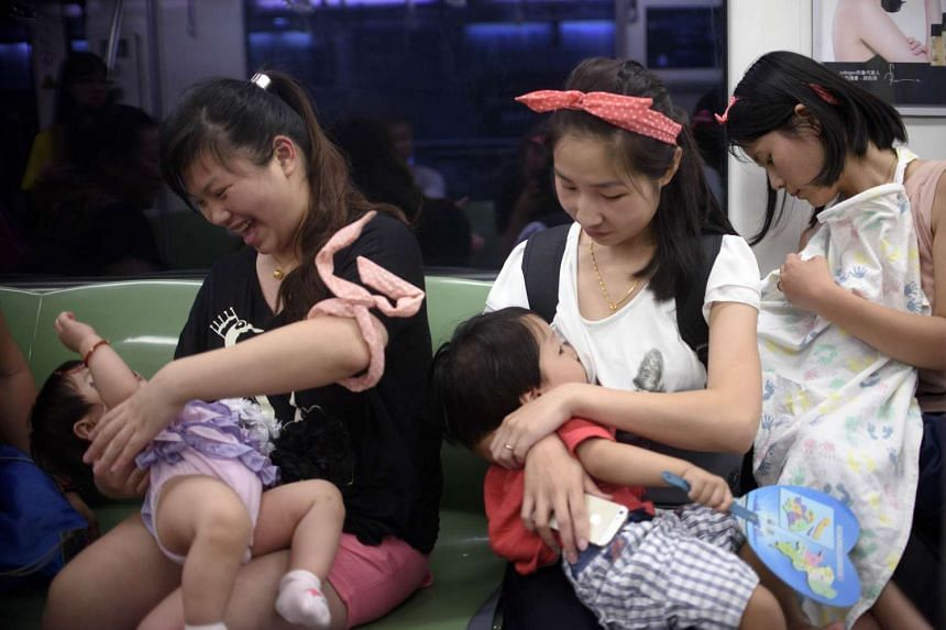 Mothers breast-feeding their babies in a commuter train as part of World Breast-feeding Week last month. Supportive employers and colleagues, as well as having a private space in the office, are factors that help make the breast-feeding journey successful