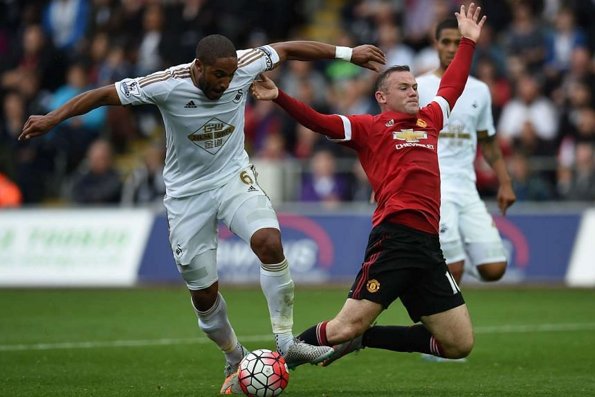 Swansea City defender Ashley Williams (left) challenges Manchester United's Wayne Rooney during the side's 2-1 victory on Sunday. The addition of French striker Anthony Martial could bring relief for Man United's woes in terms of scoring.