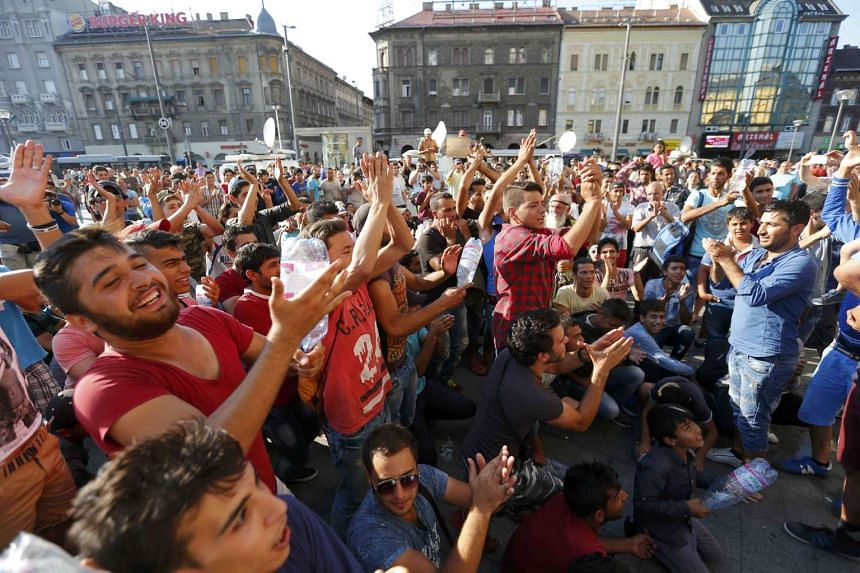 Migrants demonstrating outside the main Eastern Railway station in Budapest, Hungary, on Sept 1, 2015.