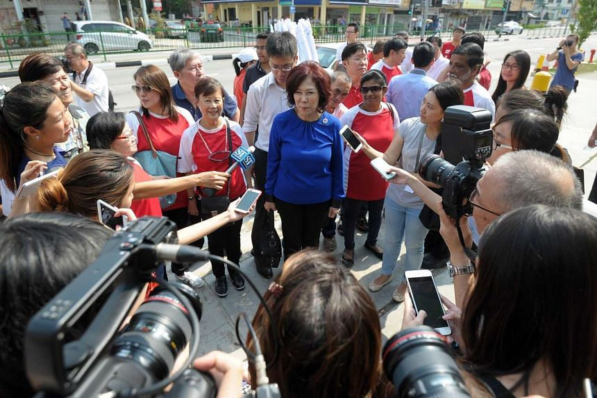 SPP member Lina Chiam (Centre) faces the media at a nomination centre as she arrives to file documents on Nomination Day ahead of a Sept 11 snap general election in Singapore on Sept 1, 2015.