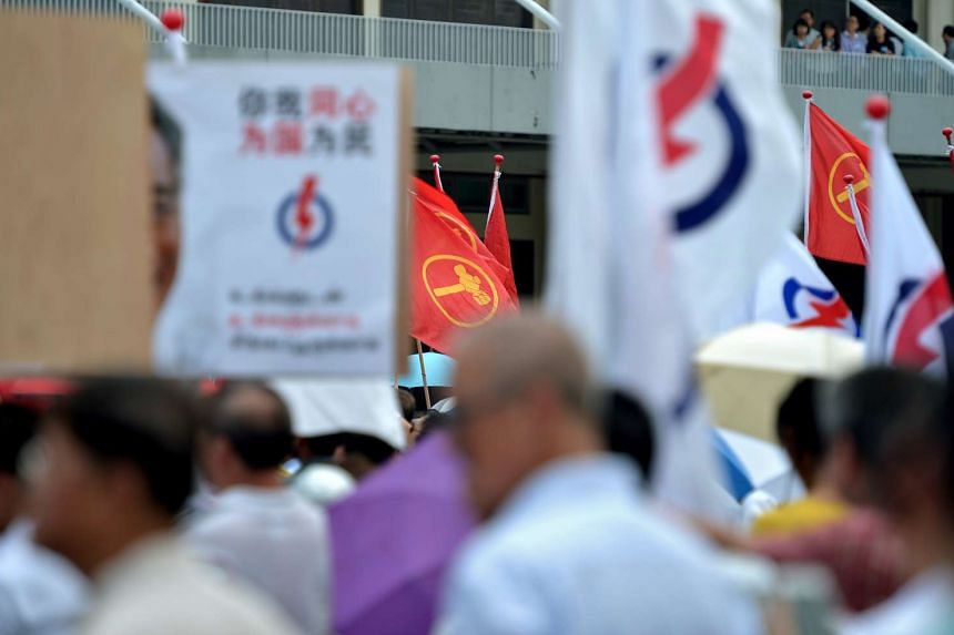 PAP and WP party flags at Raffles Institution during nomination day on Sept 1, 2015.