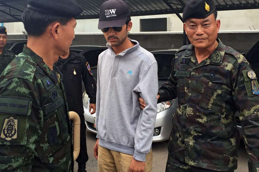 Royal Thai Army soldiers leading the Erawan Shrine bombing suspect after they arrested him in Sa Kaeo district, near the Thai-Cambodian border on Sept 1, 2015.