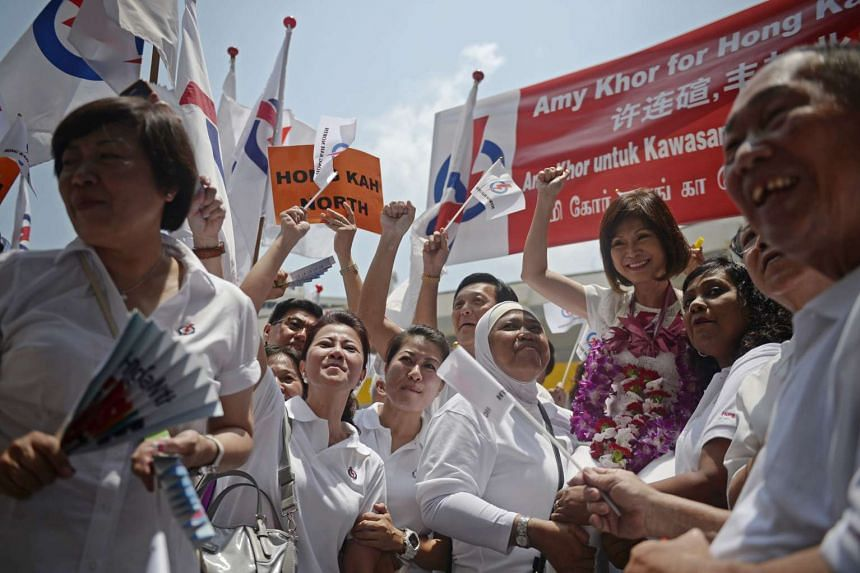 PAP's Amy Khor who is running for Hong Kah North SMC being held up by supporters at Chua Chu Kang Primary School.