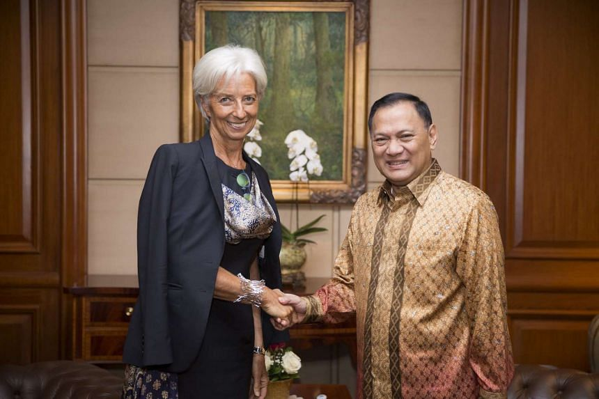 IMF managing director Christine Lagarde (left) being greeted by the Governor of the Bank of Indonesia Agus Martowardojo in Jakarta, Indonesia, on Sept 1, 2015.