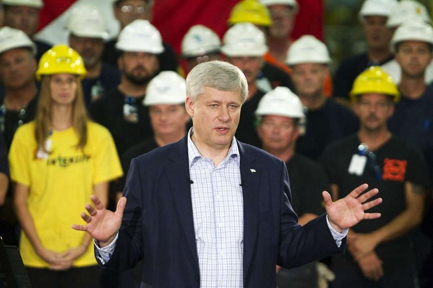 Canada's Prime Minister Stephen Harper speaking in the wake of data showing Canada slid into recession in the first half of the year, during a campaign stop in Burlington Ontario on Sept 1, 2015.