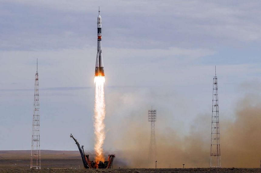 The Soyuz spacecraft carrying Aidyn Aimbetov of Kazakhstan, Sergei Volkov of Russia and Andreas Mogensen of Denmark taking off from the Baikonur cosmodrome in Kazakhstan on Sept 2.
