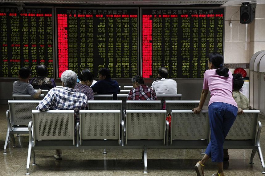Investors monitoring stock market data at a securities brokerage house in Beijing, China on Sept 1, 2015.