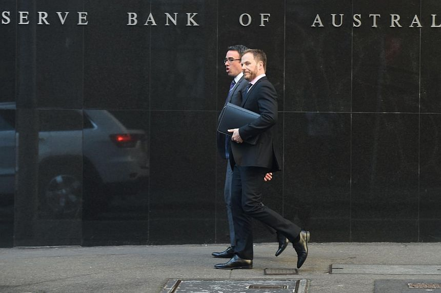 People walking past the Reserve Bank of Australia in Sydney on Sept 1, 2015.