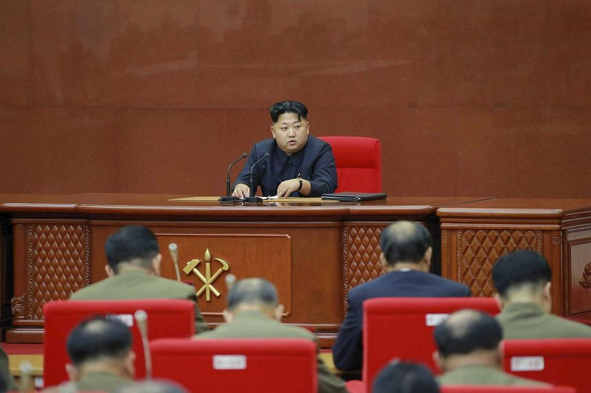 North Korean leader Kim Jong Un holding an enlarged meeting of the Central Military Commission of the Workers' Party of Korea.