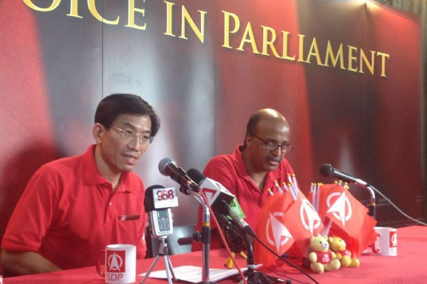 Mr Chee Soon Juan (left) and Mr Paul Tambyah speaking at the SDP Ang Mo Kio headquarters on Sept 2, 2015.