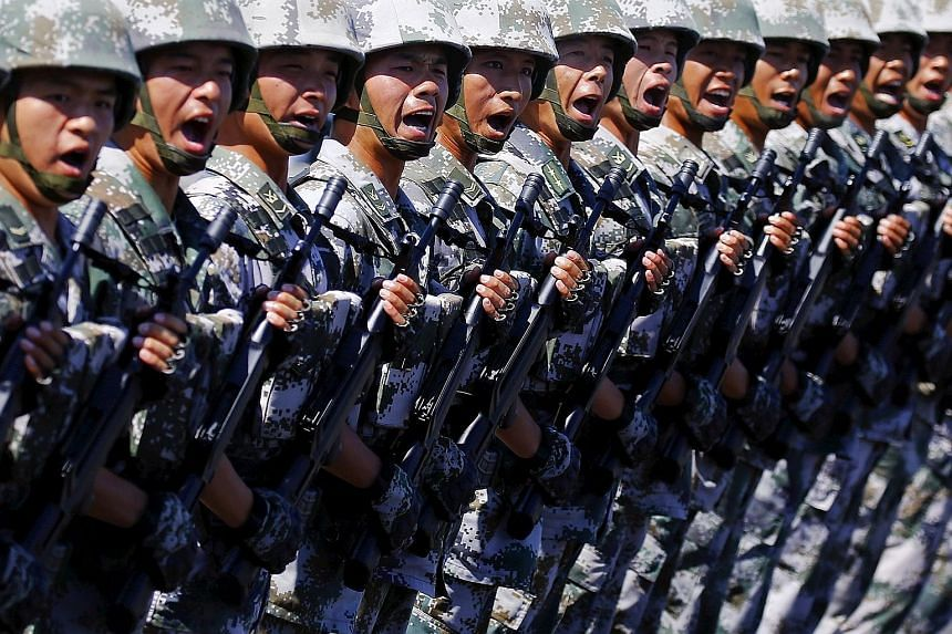 Soldiers of China's People's Liberation Army shouting as they march during a training session for a military parade to mark the 70th anniversary of the end of World War II, at a military base in Beijing recently.