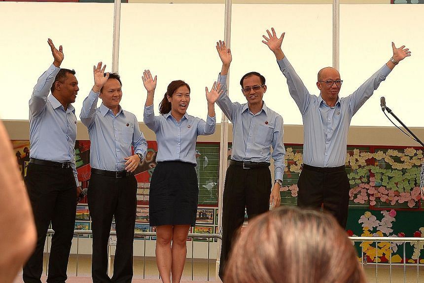 Workers' Party candidates (from left) Firuz Khan, Dylan Ng, He Ting Ru, Yee Jenn Jong and Terence Tan have been spotted pounding the pavement and distributing fliers in the last two months. PAP candidates for Marine Parade GRC (from left) Edwin Tong,