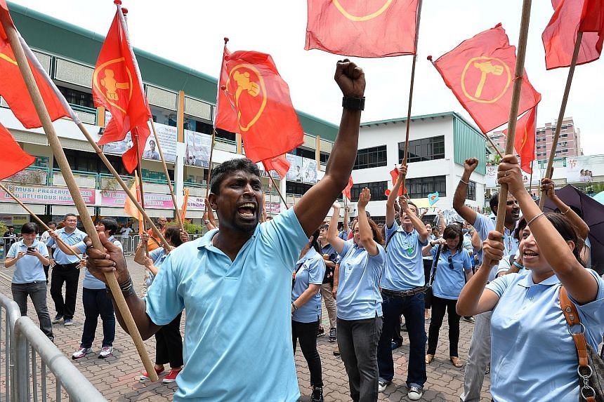 Workers' Party supporters at the Poi Ching nomination centre yesterday where the party filed nomination papers for Mr Png Eng Huat for Hougang SMC.