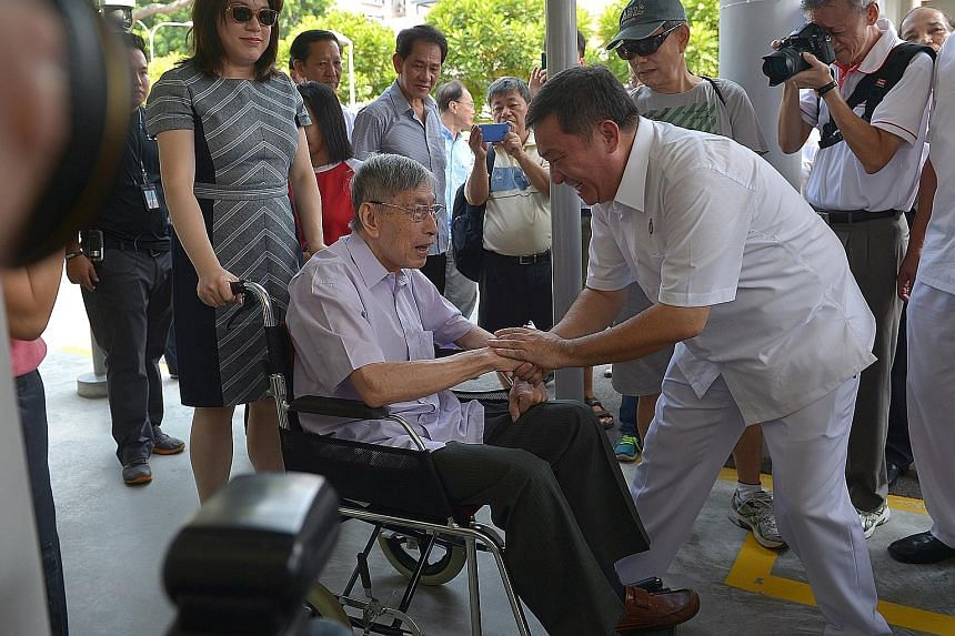 PAP candidateSitoh Yih Pin greeting Mr Chiam See Tong, who arrived in a wheelchair with his daughter Camilla, at the nomination centre in Kong Hwa School yesterday.