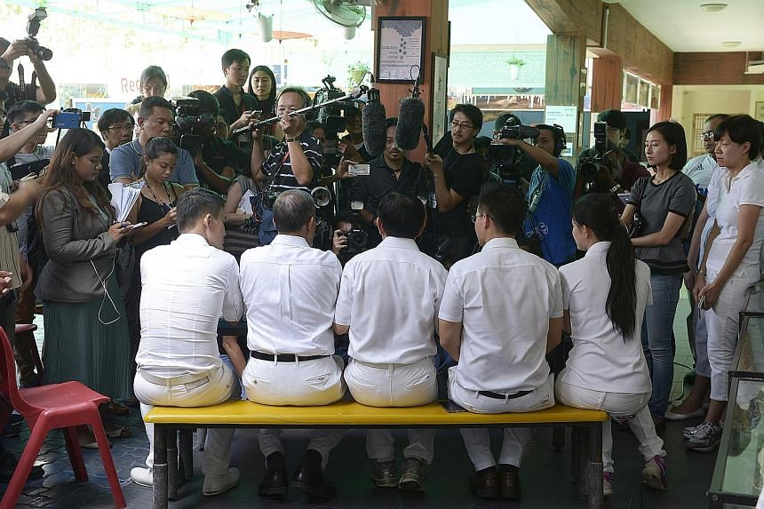 The PAP team for Tampines GRC speaking to the media at Poi Ching School after nomination closed yesterday. The team comprises (seated from left) Mr Baey Yam Keng, Minister in the Prime Minister's Office Masagos Zulkifli, Education Minister Heng Swee