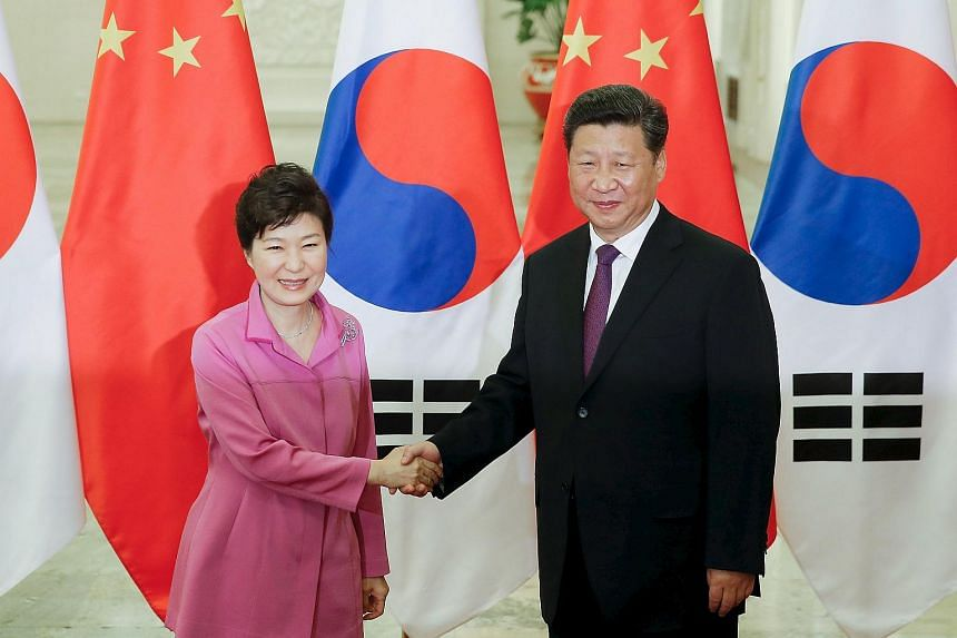 Chinese President Xi Jinping (right) shakes hands with South Korean President Park Geun Hye at The Great Hall Of The People in Beijing, China on Sept 2, 2015.