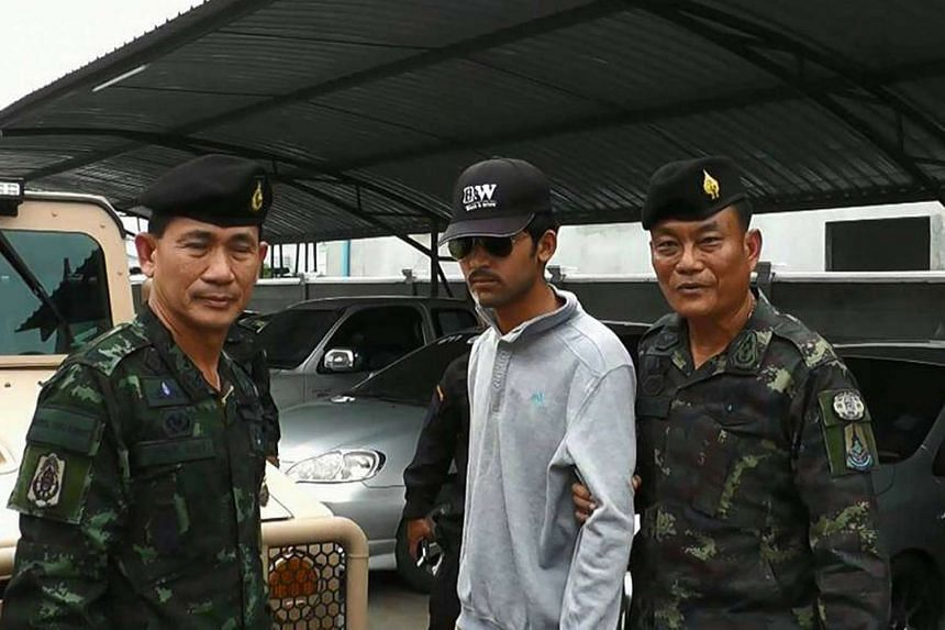 Thai police escort the Bangkok bombing suspect (centre) after he was arrested in the Aranyaprathet district of Sa Kaeo province on the Thai side of the Cambodian border on Sept 1, 2015.