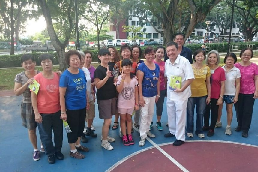 PAP's Sitoh Yih Pin with a group of Potong Pasir residents who meet to dance every morning.