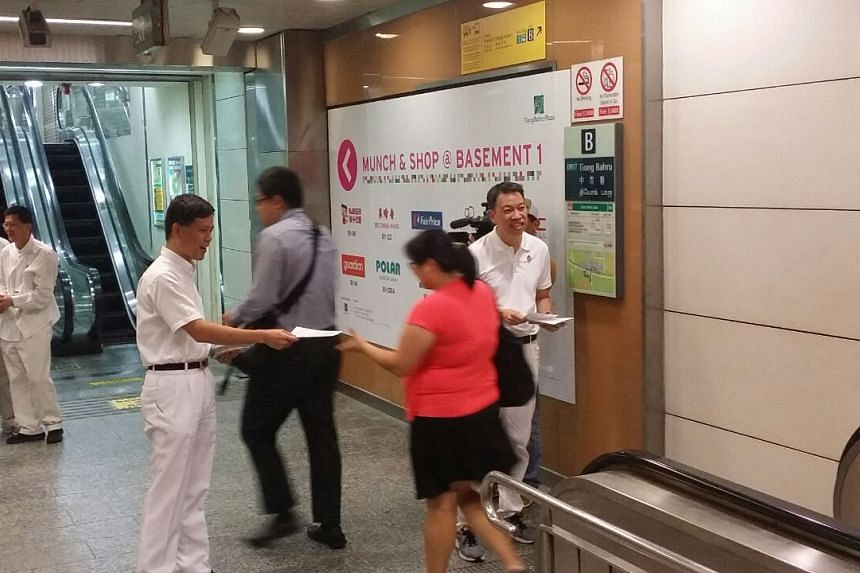 Mr Chan Chun Sing and Mr Melvin Yong, part of the PAP team for Tanjong Pagar GRC, give out flyers at Tiong Bahru MRT station.