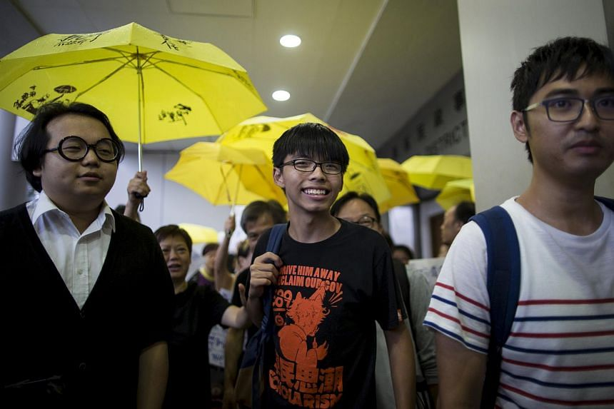 Student leader Joshua Wong (centre) arriving at the Eastern Law Courts in Hong Kong, China, on Sept 2, 2015.