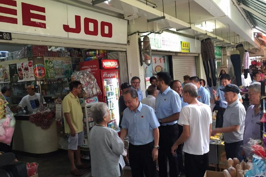 WP members, led by Mr Low Thia Khiang, meeting residents at Hougang Ave 5.