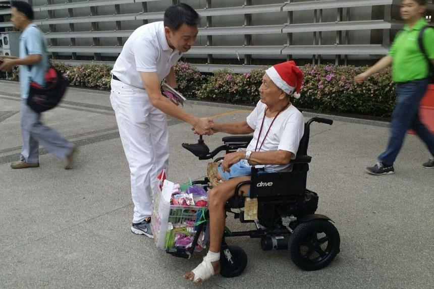 Mr Melvin Yong, of the PAP team for Tanjong Pagar GRC, speaking to an elderly resident near Tiong Bahru MRT.