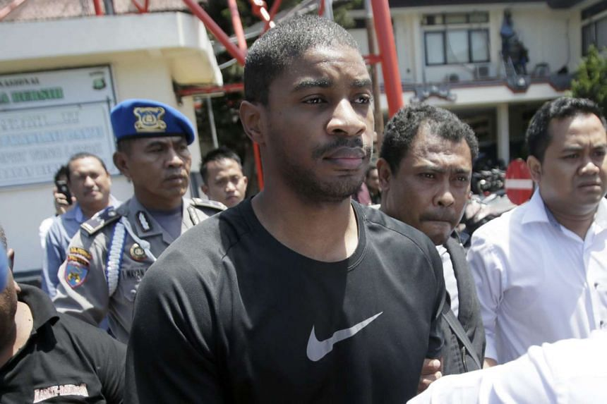 US fugitive VonTrey Clark is escorted by Indonesian police at the Bali police headquarters in Denpasar, Bali, Indonesia on Sept 2, 2015.