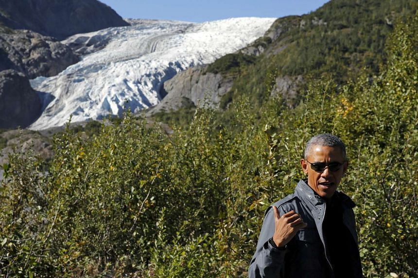 Us President Barack Obama stops to make remarks to reporters as he hikes to the Exit Glacier at Kenai Fjords National Park in Seward, Alaska on Tuesday