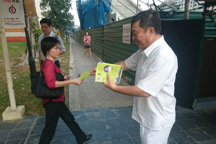 PAP's Sitoh Yih Pin giving out flyers in Potong Pasir.