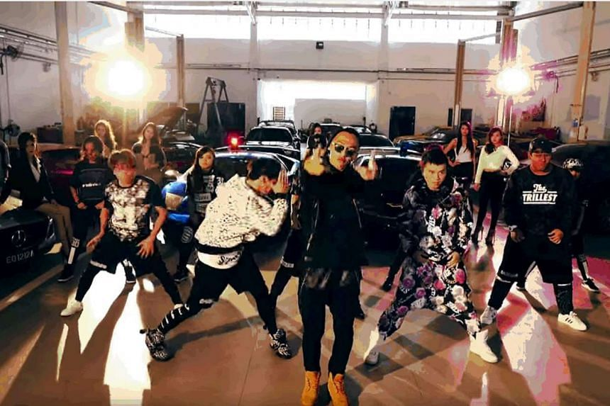 The six-minute music video Lingo Lingo features Ah Boys To Men stars rapping and dancing in front of 50 supercars.