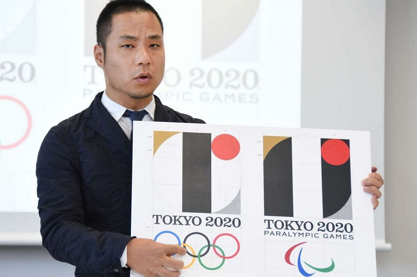 Tokyo Olympic logo designer Kenjiro Sano explaining his design last month. The logo has been dropped after a public outcry, causing further embarrassment to Olympic organisers.