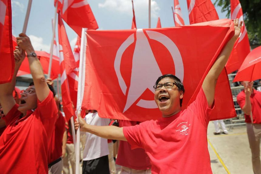 Singapore Democratic Party supporters chanted and waved flags at Assumption Pathway School yesterday.