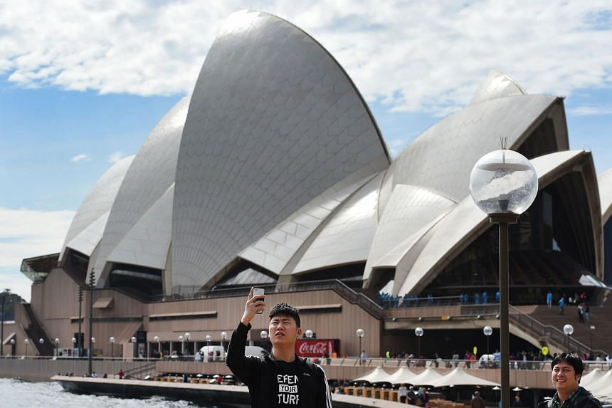 A tourist visiting the Sydney Opera House on Sept 2, 2015.