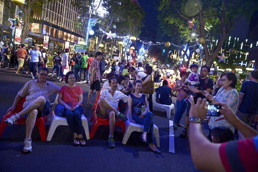 People posing for a photo on Orchard Road during Pedestrian Night on Jan 3.