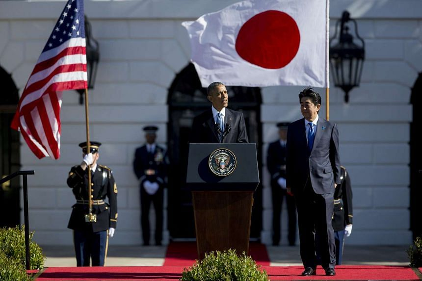 US President Barack Obama speaking during an arrival ceremony on the South Lawn of the White House with Japan's prime minister Shinzo Abe, in Washington, DC, on April 28, 2015.