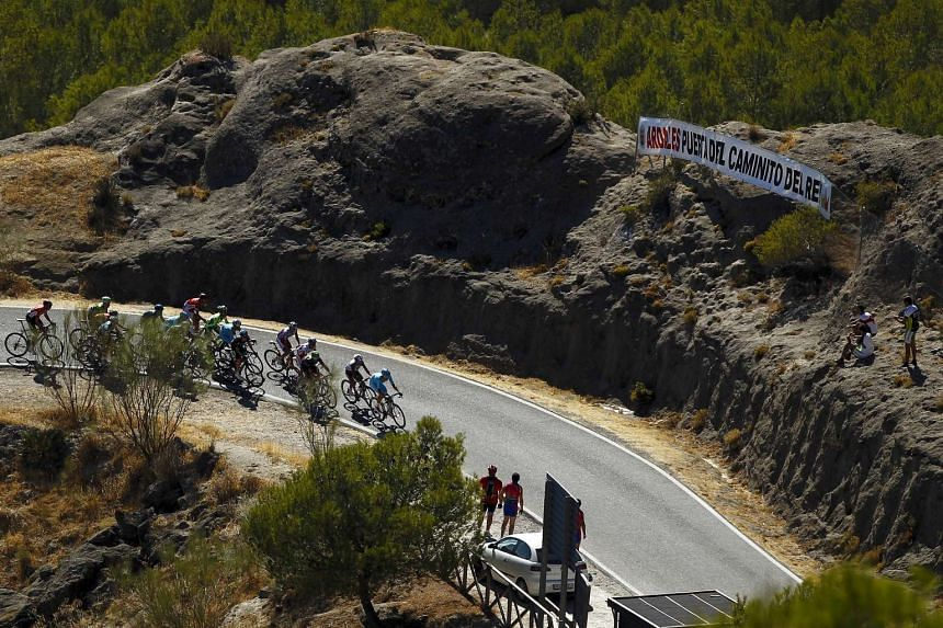 Riders compete the final kilometre to finish line during the second stage of the Tour of Spain on Aug 23, 2015.