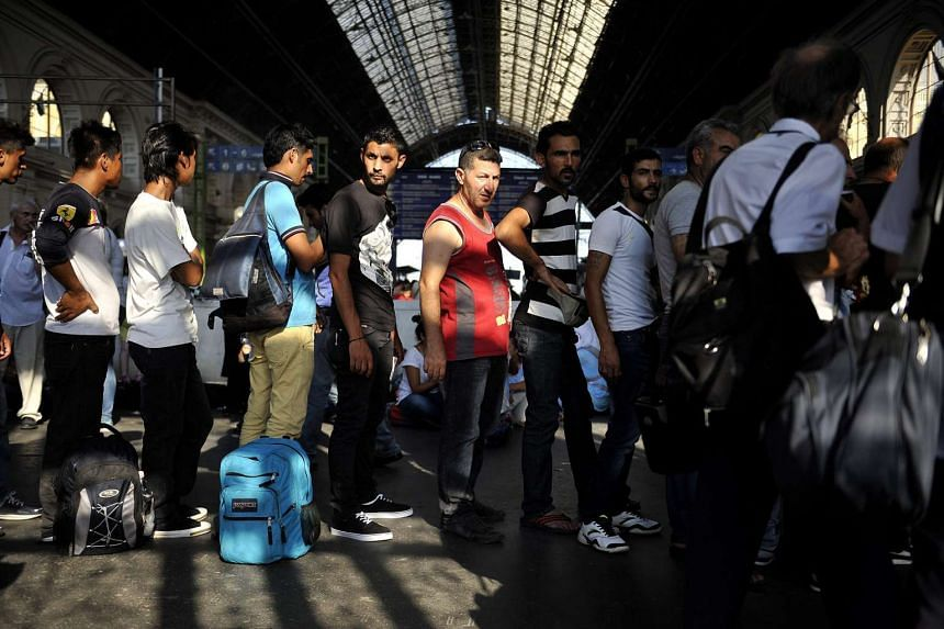 Migrants queue to buy tickets for a train to Munich, Germany at the Keleti Railway Station in Budapest, Hungary, 31 August 2015.