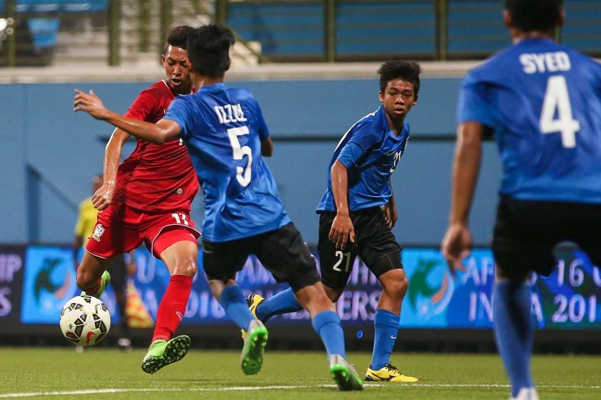 Thailand's Korawich Tasa (far left) scored a hat-trick in the 5-0 win over Singapore.