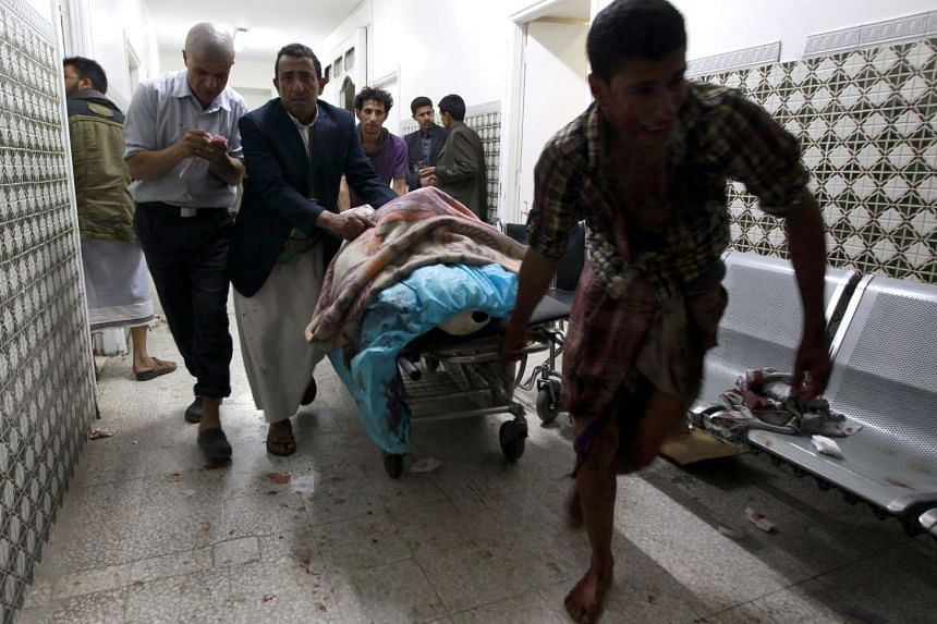 Yemenis transport a severely injured man on a gurney as he arrives at a hospital in Sanaa after being injured when two suicide bombers hit a Shiite mosque in the Yemeni capital in quick succession on Sept 2 this year.